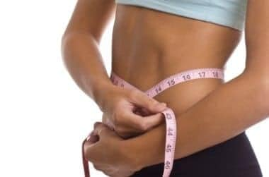 weight loss girl with measuring tape